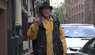 Old panhandler pays be incumbent on a younger panhandler here nail and hooker in Amsterdam