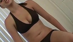 Hawt blond babe in bikini jerking off guy's cock in POV jacket