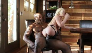 Golden-haired princess plays with the biggest black knob in her life