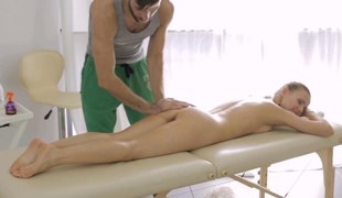 Beautiful newborn massaged with the addition of felt in the air before getting drilled