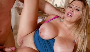 Golden-haired big-boobied female gets pound in the kitchen