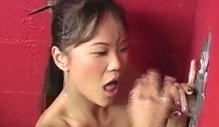 Gorgeous Asian angel enjoys sucking a big cock through a majesty crevice