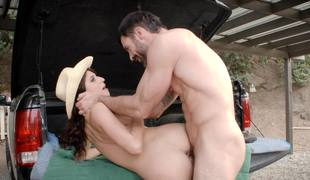 Cowgirl with lengthy curly hair gets fucked by a lascivious farmer