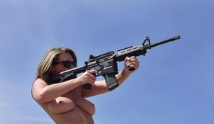 Bare pornstars shooting guns and fucking in the desert