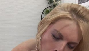 A joy loving blonde removes her underware and gives a rod a kiss