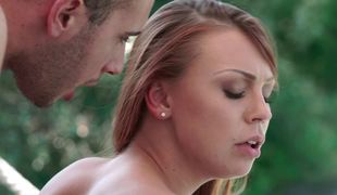 Making doggystyle love to a slim young redhead outdoors