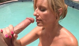 Breasty blonde milf Jodi West sucks a big shlong by the pool